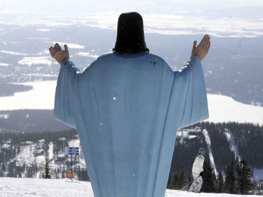 The statue of Jesus Christ at Whitefish Mountain Resort overlooks Whitefish Lake and the Flathead Valley in Whitefish.