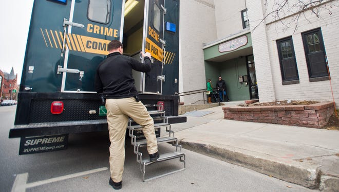 """Vermont State Police investigators work at South Square apartments on College Street in Burlington in March following the fatal shooting of Ralph """"Phil"""" Grenon, 76, by police."""