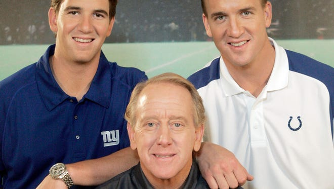 In this May 8, 2008, file photo, Archie Manning, center, is joined by his sons Eli Manning, left, and Peyton Manning after the taping of a commercial in Beverly Hills, Calif. Archie speaks deliberately and carefully when addressing whether his 39-year-old son, Peyton, might be playing his final NFL game when he returns to the Super Bowl on Feb. 7, 2016. Archie and his other NFL quarterback son, Eli, are clear about one thing, though; they are proud of the way Peyton overcame new challenges in the twilight of his career.