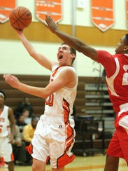 Cumberland's Casey Ordille (left) puts up a shot over