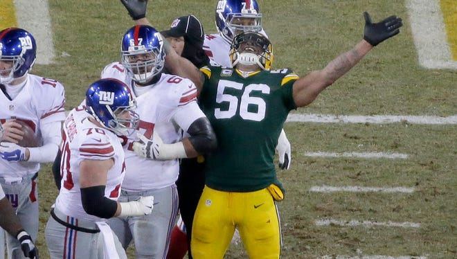 Green Bay Packers linebacker Julius Peppers (56) celebrates a sack during the second quarter of a wild-card playoff game against the New York Giants at Lambeau Field on Jan. 8, 2017.