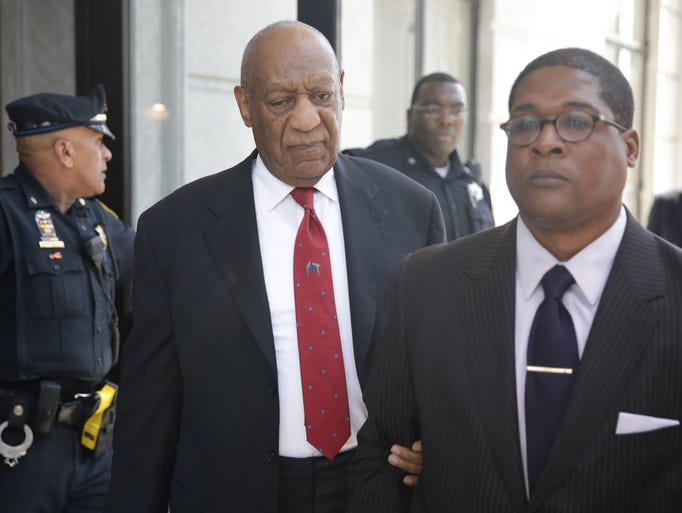 Bill Cosby walks out of the Montgomery County Courthouse