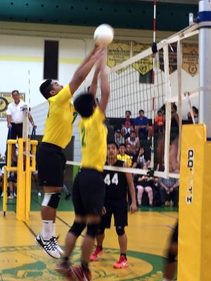 John F. Kennedy Islanders' Dean Jesus and James Mallanao put up a block as the Islanders defeated the Father Duenas Friars 25-13, 25-22 at home on Tuesday, Apr. 12.