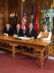 Rep. Steve Fitzpatrick, R-Great Falls; Sen. Chas Vincent, R-Libby; Gov. Steve Bullock; and CSKT Chairman Vernon Finley sign the CSKT water compact before it headed to the U.S. Congress in 2015.