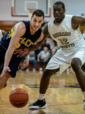 Elco's Colton Lawrence drives to the hoop against Neumann-Goretti's