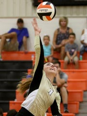 Henrietta's Lizzie Riordan spikes the ball in the match against Boyd Saturday, Aug. 12, 2017, at the Cool in Boomtown tounament in Burkburnett.