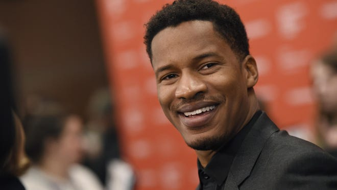 "Nate Parker, the star, director and producer of ""The Birth of a Nation,"" arrives at the premiere of the film at the 2016 Sundance Film Festival on Monday, Jan. 25, 2016, in Park City, Utah."