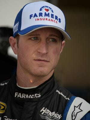 Kasey Kahne looks from the garage during practice for the Daytona 500 in February.