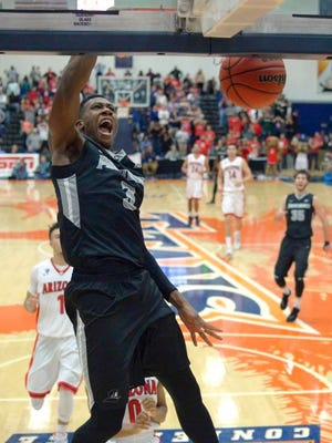 Providence guard Kris Dunn dunks during the second half of an NCAA college basketball game against Arizona at the Wooden Legacy tournament, Friday, Nov. 27, 2015, in Fullerton, Calif. Providence won 69-65.