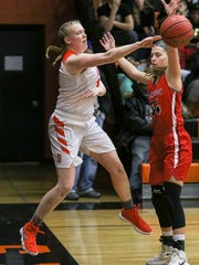 Somerville's Meghan Douglas, left, passes against Bound