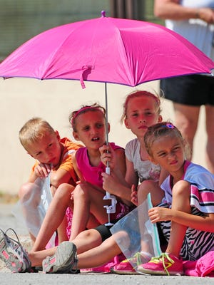 Mason Trimberger, from left, Sophia Hermans, Cadence Trimberger, and Maisie Hermans watch Sunday's parade during the 53rd Annual Belgian Days in Brussels.