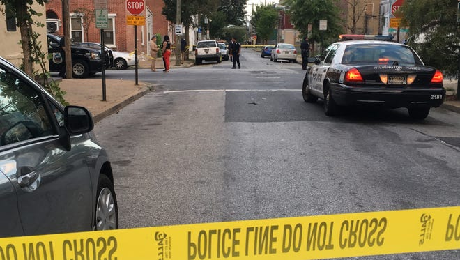 Wilmington police investigate a shooting at Ninth and Spruce streets on Tuesday night.