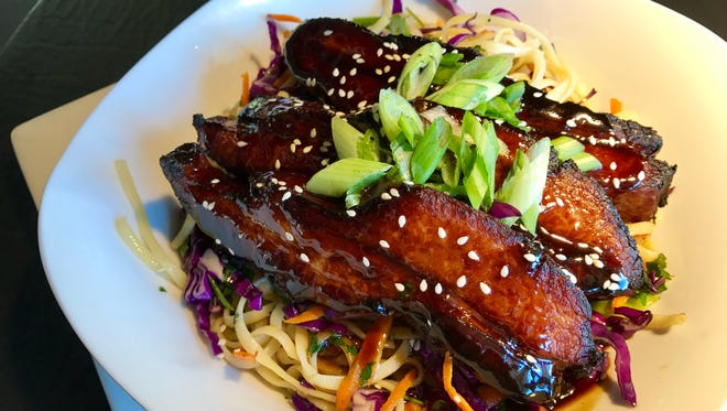 Asian pork belly pasta is a Hot Dish from King's Kitchen in Fort Myers.
