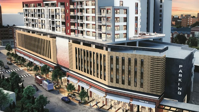 A rendering of the 10-story parking garage and apartment building planned for City Lot 1 in downtown East Lansing as part of the Center City District project.