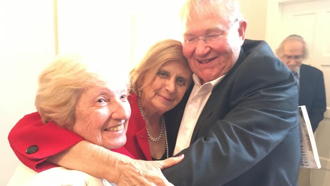 "Debbie Bornstein Holistat and her father Michael Bornstein wrote a book about his experiences as a four-year-old who survived Auschwitz. The book, ""Survivor's Club,"" and its front cover led to a reunion of three of the children - Bornstein, Sarah Ludwig (right) and Tova Friedman (center) - on June 11."