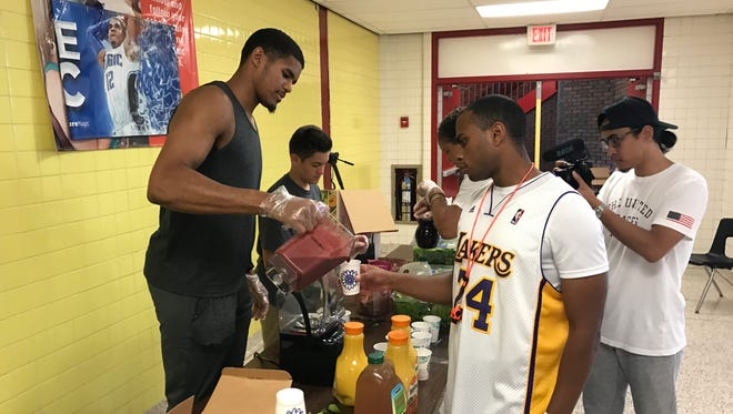 Detroit Pistons forward Tobias Harris serves as smoothie during his basketball camp in New York on Thursday, June 29, 2017.