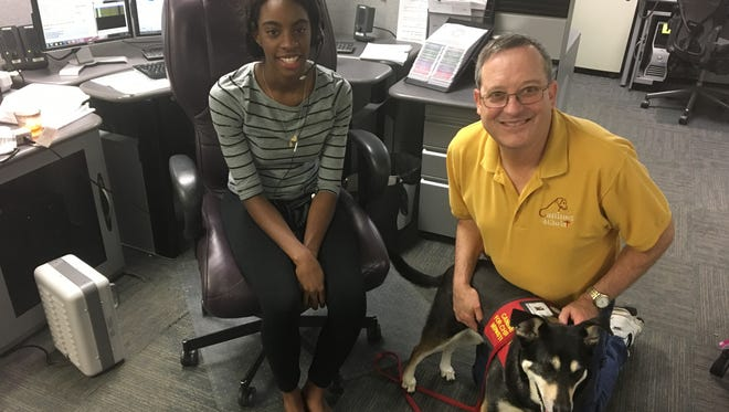 Chaplain Ron Leonard and service dog Molly visit with Mycha Josey and other 911 dispatchers in Ashland City Monday, July 31.