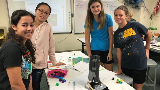 Eighth-graders, from left, Madison Boni, Ella Yeu, Casey Lowe and Claire Atkinson designed an ankle foot orthotic for a cerebral palsy patient as part of a Project Lead the Way class at Sycamore Junior High School.