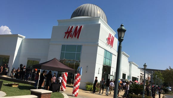 Hundreds wait for the Thursday noon opening of H&M