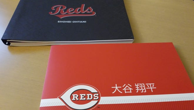 The materials the Cincinnati Reds sent to Japanese star Shohei Ohtani. When opened, the red book played a 12-minute video, while the black book was stuffed with slickly presented information about why Cincinnati would be the right fit.