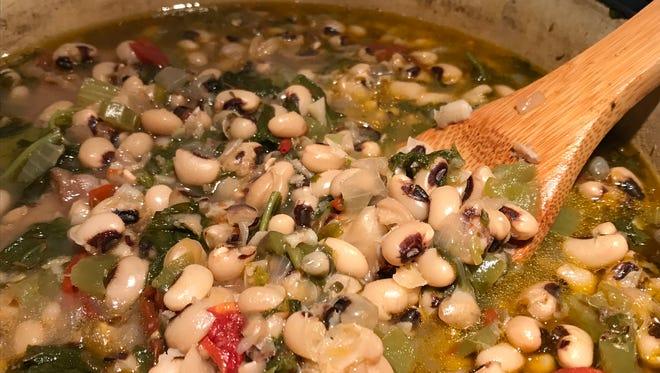 Black-eye peas cooked with ham hocks and collard greens.