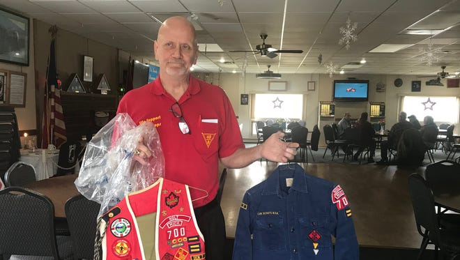 Mike Brokenshire, the chef de gare of 40et8-Voiture 946, a veterans organization in Windsor Township, shows his gear from his own Boy Scout and Cub Scout days. He's disappointed that the Boy Scouts of America blocked his veterans' group from chartering a Cub Scout pack. The pack has been in trouble with local Scout leaders, apparently over popcorn sales and personality conflicts.