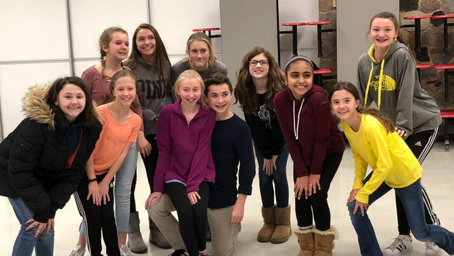 """Pilgrim Park Middle School students will be putting on a production of """"Bye Bye Birdie"""" Feb. 8-10 at the Sharon Lynne Wilson Center for the Arts. Pictured at a recent rehearsal are, from left, Maddie Pankow, Jenna Prinslow, Natalie Palacios, Jazmin Gioiosa, Lainee Grintjes, Ailie Reid, Nehar Poohi, Jacklyn Warber and Amanda Roeder (behind Jacklyn). In the center are Grace O'Connell and Max Donohue (kneeling)."""