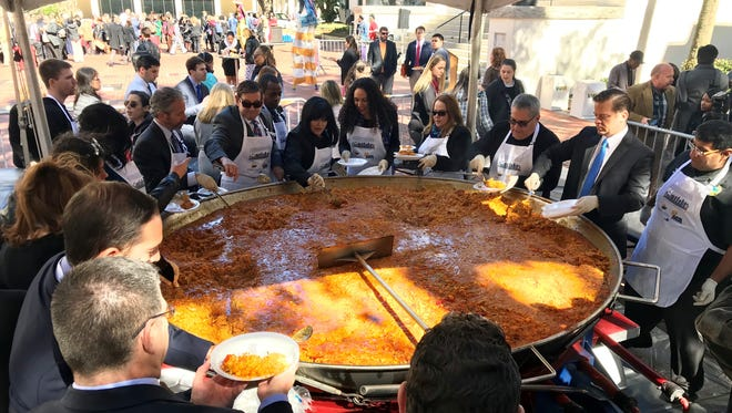 Lt. Gov. Carlos Lopez-Cantera (far right, blue tie), was among public officials serving paella Wednesday in the Capital Courtyard as part of the 30th annual Miami-Dade County Days.
