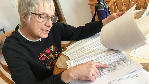 "Maureen Borchardt goes through some of her meticulously-kept walking records. ""They are kind of like a diary,"" she said."
