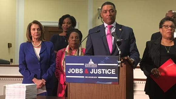 "Rep. Cedric Richmond, D-La., chairman of the Congressional Black Caucus, and other caucus members unveil the group's ""Jobs and Justice Act."""