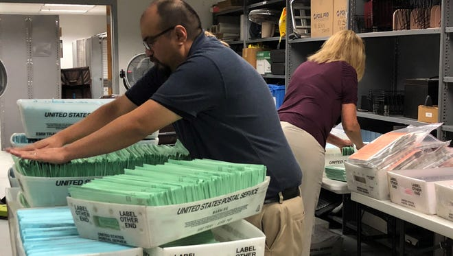 Elections officials worked Wednesday to quickly get ballots counted and tallied.