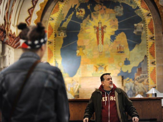 Pure Detroit tour guide Michael Boettcher  tells visitors