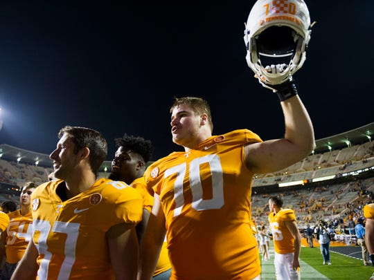 Tennessee offensive lineman Ryan Johnson (70) holds his helmet in the air after a game between Tennessee and Southern Miss at Neyland Stadium in Knoxville, Tennessee, on Saturday, Nov. 4, 2017. Tennessee defeated Southern Miss 24-10.