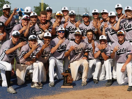 Plymouth Wildcats baseball players hold up three fingers to represent their district three-peat.