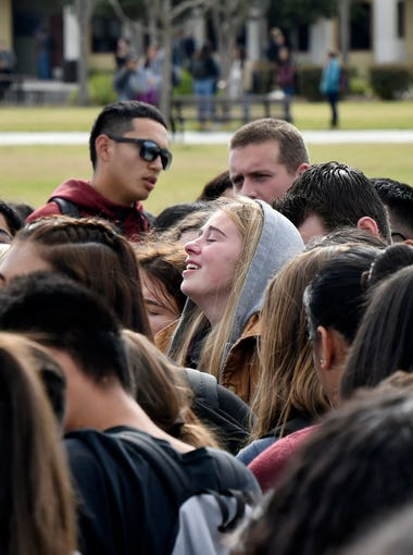 Mission Oak High School students gather at Hawks Landing in the center of campus to remember the shooting victims during the National School Walkout in Tulare, Calif.