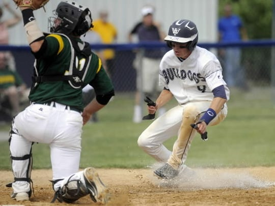 Brock Gladfelter prepares for a homeplate collision during Monday's semifinal game.