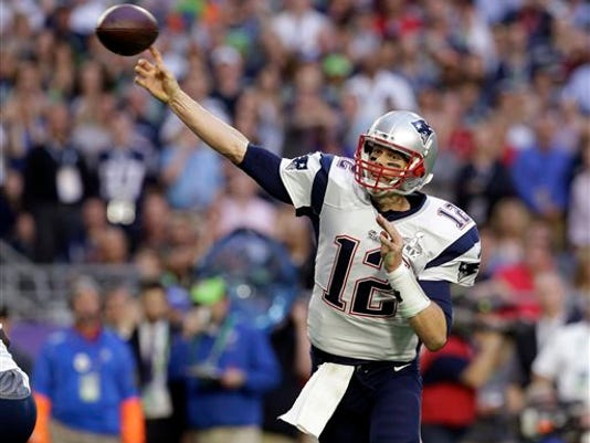FILE - In this Feb. 1, 2015, file photo, New England Patriots quarterback Tom Brady (12) throws a pass during the first half of the NFL Super Bowl XLIX football game against the Seattle Seahawks in Glendale, Ariz.