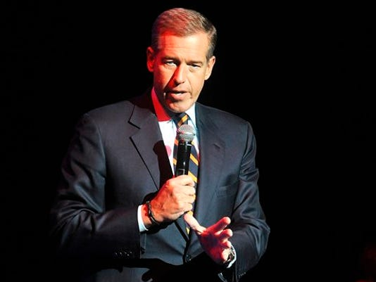 FILE - In this Nov. 5, 2014 file photo, Brian Williams speaks at the 8th Annual Stand Up For Heroes, presented by New York Comedy Festival and The Bob Woodruff Foundation in New York. Next week marks the end of Brian Williams' six-month suspension from NBC News for exaggerating his role in news reporting, but he isn't expected back on the air in his new job at MSNBC for at least another month.