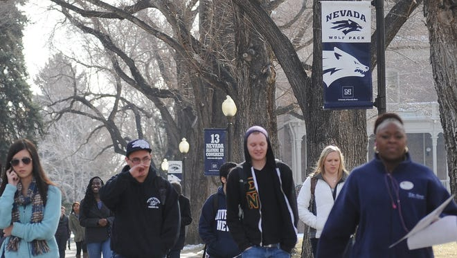 Students walk next to the quad on campus as the new semester begins at UNR in this 2013 file photo.