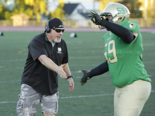 Oshkosh North head coach Chris Kujawa aims to lead the Spartans back to the playoffs this season.