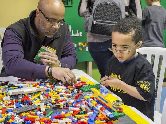 Mark Freeman and his son Jacob, 6, have fun making