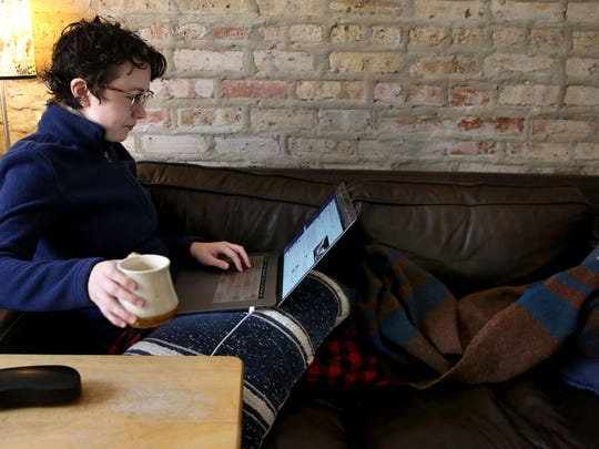 Glitch.com software engineer Melissa McEwen, 33, works from her Logan Square neighborhood home on March 12, 2020. McEwen has worked remotely for five years. (Antonio Perez / Chicago Tribune/TNS)
