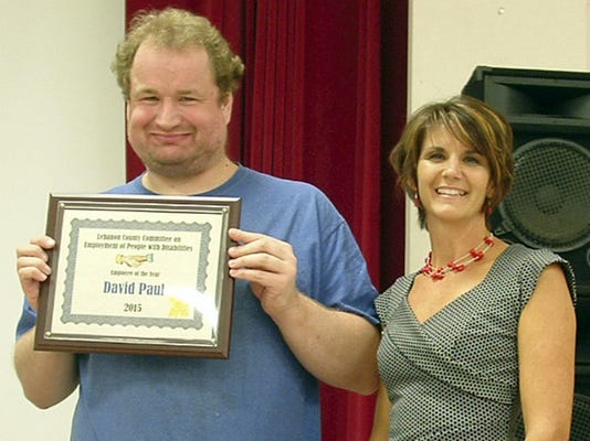 Male Employee of the Year: Job coach Deb Eberly, right, presents David Paul  the Male Employee of the Year. He is employed by Kmart. Submitted