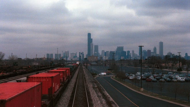 The Chicago skyline becomes visible as the train rolls into the windy city.