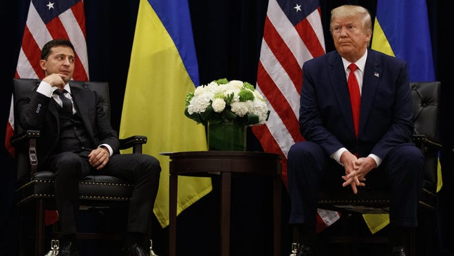 """FILE - In this Sept. 25, 2019, file photo, President Donald Trump meets with Ukrainian President Volodymyr Zelenskiy at the InterContinental Barclay New York hotel during the United Nations General Assembly, in New York. It's the story of a president who either had a """"perfect phone call"""" with Ukraine or abused his power and should be removed from office. What to watch as presidential impeachment arguments get underway in the Senate for only the third time in American history. (AP Photo/Evan Vucci, File)"""