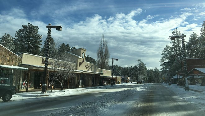 Sudderth Drive was shaking off Thursday evening's snowfall by Friday morning.