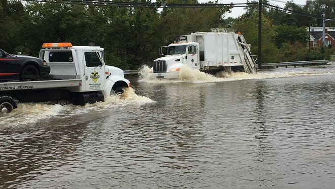 Route 13 at Alexander Avenue and Priscilla Street were blocked to traffic due to flooding on Friday, Sept. 30, 2016. Stalled vehicles were towed.