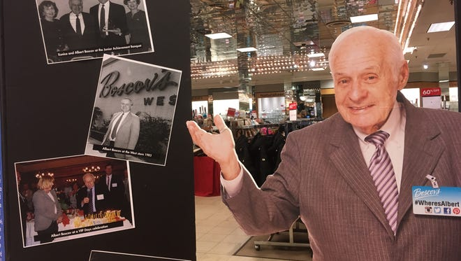 A cutout of Albert Boscov greets customers in the Concord Mall store on Saturday.