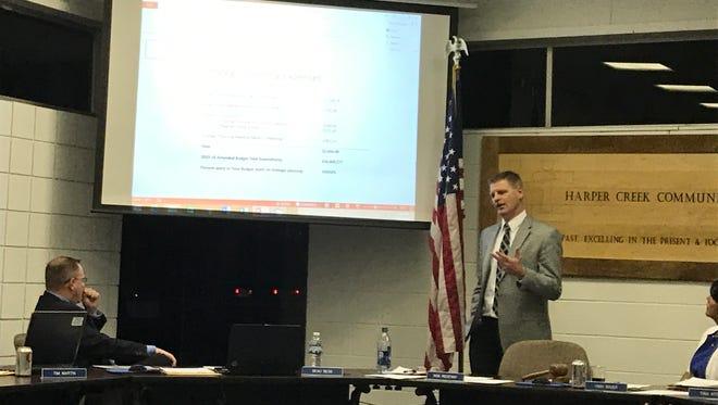 Harper Creek Superintendent Rob Ridgeway, right, makes a point during the Feb. 13 school board meeting.