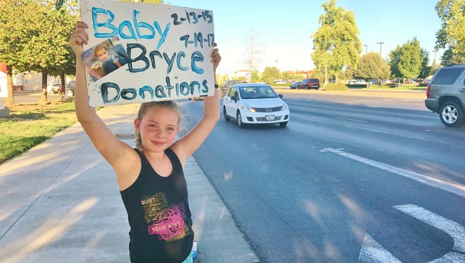 Staci Schriever, 10 of Visalia, helped raise money for the family of 2-year-old Bryce George.